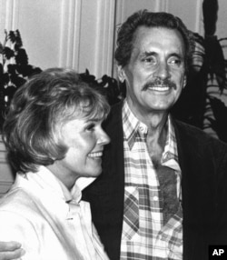 In this July 18,1985 file photo, Doris Day and Rock Hudson speak at a news conference in Monterey, Calif.