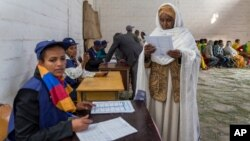 A woman looks at the election paper before voting in Ethiopia's general election, in Addis Ababa, Ethiopia, May 24, 2015.