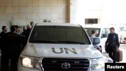 U.N. vehicles carrying a U.N. chemical weapons investigation team arrive in Damascus September 25, 2013. U.N. chemical weapons inspectors returned to Syria on Wednesday to continue investigating allegations of chemical weapons use in the country's two-and