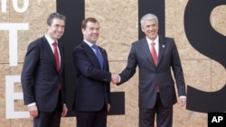 From left, NATO Secretary General Anders Fogh Rasmussen, Russian President Dmitry Medvedev and Portuguese Prime Minister Jose Socrates are seen prior to participating in a NATO Russia Council meeting at a NATO summit in Lisbon on Saturday Nov. 20, 2010.