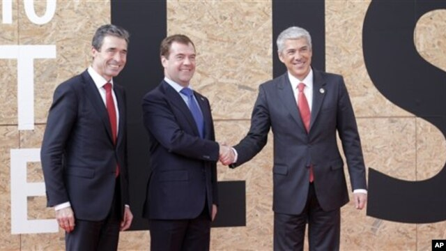 From left, NATO Secretary General Anders Fogh Rasmussen, Russian President Dmitry Medvedev and Portuguese Prime Minister Jose Socrates are seen prior to participating in a NATO Russia Council meeting at a NATO summit in Lisbon, 20 Nov 2010