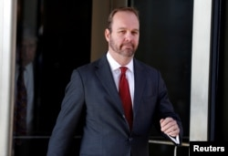 FILE - Rick Gates, former campaign aide to U.S. President Donald Trump, departs after a bond hearing at U.S. District Court in Washington, Dec. 11, 2018.