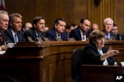 Phoenix prosecutor Rachel Mitchell questions Christine Blasey Ford as Senators, from left, Sen. Mike Crapo, R-Idaho, Sen. Jeff Flake, R-Ariz., Sen. Ben Sasse, R-Neb., Sen. Ted Cruz, R-Texas, Sen. Mike Lee, R-Utah., and Sen. John Cornyn, R-Texas, listen during the Senate Judiciary Committee hearing, Sept. 27, 2018.