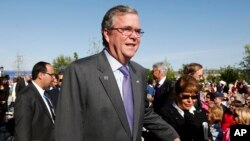 Former Florida Governor Jeb Bush and his wife Columba arrive for the dedication of the George W. Bush presidential library on the campus of Southern Methodist University in Dallas, April 25, 2013.