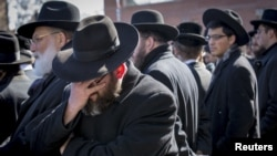 Mourners attend the funeral for seven children killed in a Brooklyn fire in New York, March 22, 2015.