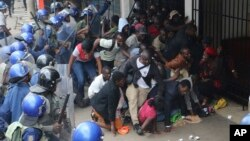 FILE: Police surround opposition party supporters who had gathered to hear a speech by the country's top opposition leader in Harare, Wednesday, Nov. 20, 2019.