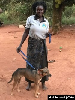 Philda Akum, a former war victim, received her dog Sadiq from the comfort dog project in Pece village, Gulu, Uganda.