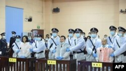 Journalist Chen Jieren, center, Liu Min, left, and Chen Weiren attend their sentencing at the People's Court of Guiyang county in China's Hunan province, in this photo taken April 30, 2020, and received May 1 from the Hunan Province Higher People's Court.