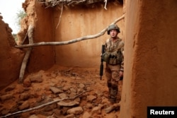 A French soldier of the 2nd Foreign Engineer Regiment inspects a damaged house during an area control operation in the Gourma region during Operation Barkhane in Ndaki, Mali, July 28, 2019.