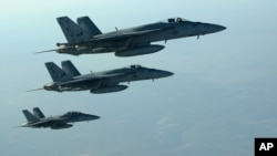 FILE - A formation of U.S. Navy F-18E Super Hornets leaves after receiving fuel from a KC-135 Stratotanker over northern Iraq.