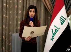 Nobel Peace Prize recipient Nadia Murad, speaks during a meeting with her country's President Barham Salih and other dignitaries, in Baghdad, Iraq, Wednesday, Dec. 12, 2018.