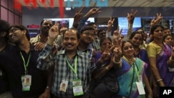 Indian Space Research Organization scientists and other officials celebrate the success of Mars Orbiter Mission at their Telemetry, Tracking and Command Network complex in Bangalore, India, Sept. 24, 2014.