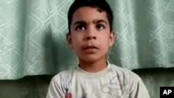 Văn phòng Truyền thông Houla công bố bức ảnh cậu bé Ali el-Sayed, 11 tuổi, sống sót trong cuộc tàn sát 108 người ở Houla