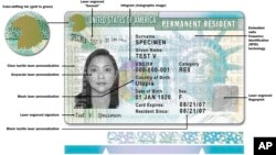 This image released by USCIS shows a sample of the front of the redesigned green card.