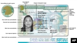 This image shows a sample of the front of the redesigned green card carried by foreign-born residents living permanently in the U.S.
