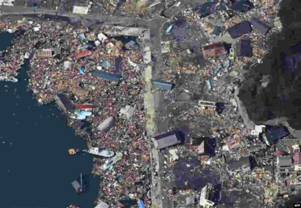 Debris covers part of a fishing port on Izushima island in Onagawacho, northern Japan, Monday, March 14, 2011, three days after a powerful earthquake-triggered tsunami hit the country's east coast. (AP Photo/The Yomiuri Shimbun, Atsushi Taketazu) JAPAN OU