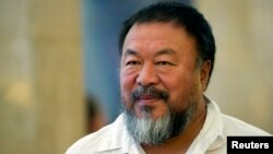 FILE - Chinese artist Ai Weiwei arrives at the town hall in Berlin, Germany, Aug. 13, 2015.