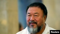 FILE - Dissident Chinese artist Ai Weiwei arrives at the town hall in Berlin, Germany.