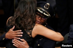 U.S. First Lady Michelle Obama hugs Dallas police chief David Brown at a memorial service following the multiple police shootings in Dallas, Texas, U.S., July 12, 2016.