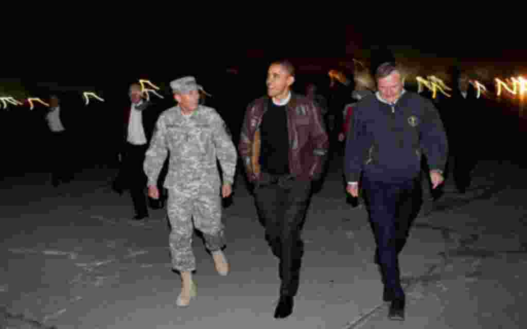 Obama walks with Gen. David Petraeus and U.S. Ambassador Karl Eikenberry after arriving at Bagram Air Field in Afghanistan, Dec. 3, 2010
