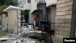 A general view of the damage caused by a bomb blast is seen at the gate of the Iranian ambassador's residence in Tripoli, Libya, Feb. 22, 2015.