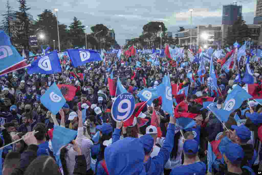 Supporters of the Democratic Party waving Albanian and party flags participate in the political rally in capital Tirana, Albania on Friday, April 23, 2021. Albania holds parliamentary elections on Sunday amid the virus pandemic and a bitter political riva