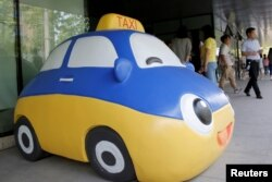 A mascot of Didi Chuxing is seen at the company's headquarters in Beijing, China, May 18, 2016