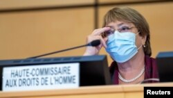 United Nations' High Commissioner for Human Rights Michelle Bachelet adjusts her glasses during the opening of 45th session of the Human Rights Council, at the European U.N. headquarters in Geneva, Switzerland September 14, 2020. Martial Trezzini/Pool via
