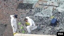 聯邦調查局正在爆炸現場檢查找到的碎片﹐希望能彙集到線索。
