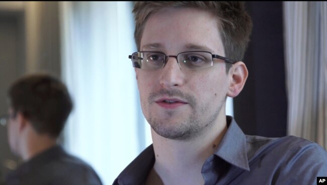 FILE - This photo provided by The Guardian Newspaper in London shows Edward Snowden, who worked as a contract employee at the National Security Agency, June 9, 2013, in Hong Kong.