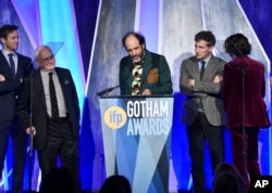 "Director Luca Guadagnino (C) accepts the best feature award for ""Call Me By Your Name"" at the 27th annual Independent Film Project's Gotham Awards at Cipriani Wall Street on Nov. 27, 2017, in New York."