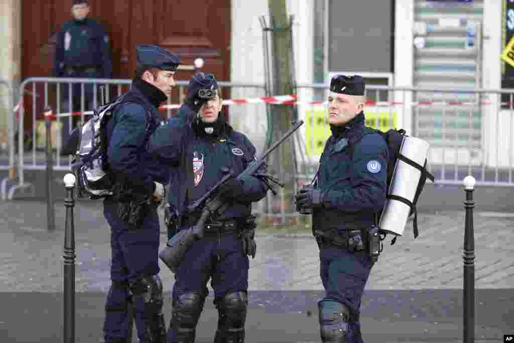 Security officers patrol Republique Square in Paris, Jan. 11, 2015.