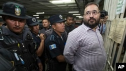 Police search Mexico's former Veracruz state governor Javier Duarte before returning him to his jail cell, after he attended a court hearing in Guatemala City, June 27, 2017.