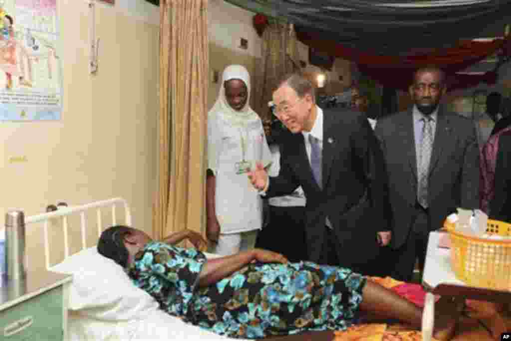 United Nations Secretary-General Ban Ki-moon, center, talks to a patient in a hospital in Abuja, Nigeria, Sunday, May 22, 2011. Ban arrived in Nigeria on Sunday for a two-day visit, weeks after Africa's most populous nation held elections viewed as the fa