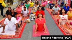 FILE- A yoga class being held in Gurgaon, near New Delhi is one of hundreds of such sessions which are gaining in popularity in India.