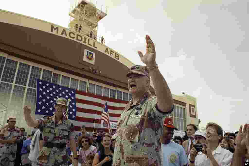 U.S. General Norman Schwarzkopf waves to the crowd after a military band played a song in his honor at welcome home ceremonies at MacDill Air Force Base in Tampa, Florida, April 22, 1991.