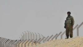 An Israeli soldier secures an area near the border between Israel and Egypt, June 18, 2012.