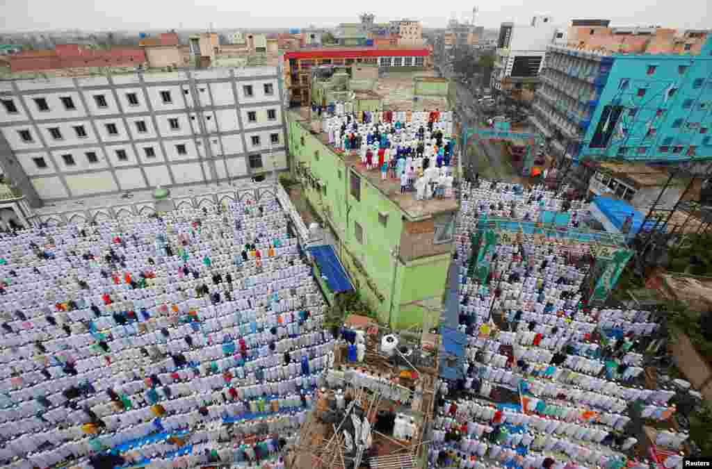 Muslims offer Eid al-Fitr prayers marking the end of the holy fasting month of Ramadan in Howrah, on the outskirts of Kolkata, India.