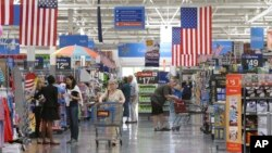 FILE - Customers shop at a Wal-Mart Supercenter store in Springdale, Arkansas.
