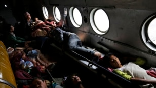 Nepalese victims of Saturday's earthquake lie inside an Indian air force helicopter as they are evacuated from Trishuli Bazar to Kathmandu airport in Nepal, April 27, 2015.