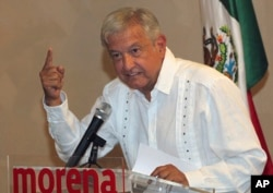 FILE - Presidential hopeful Andres Manuel Lopez Obrador gives a press conference in Mexico City, June 9, 2017.