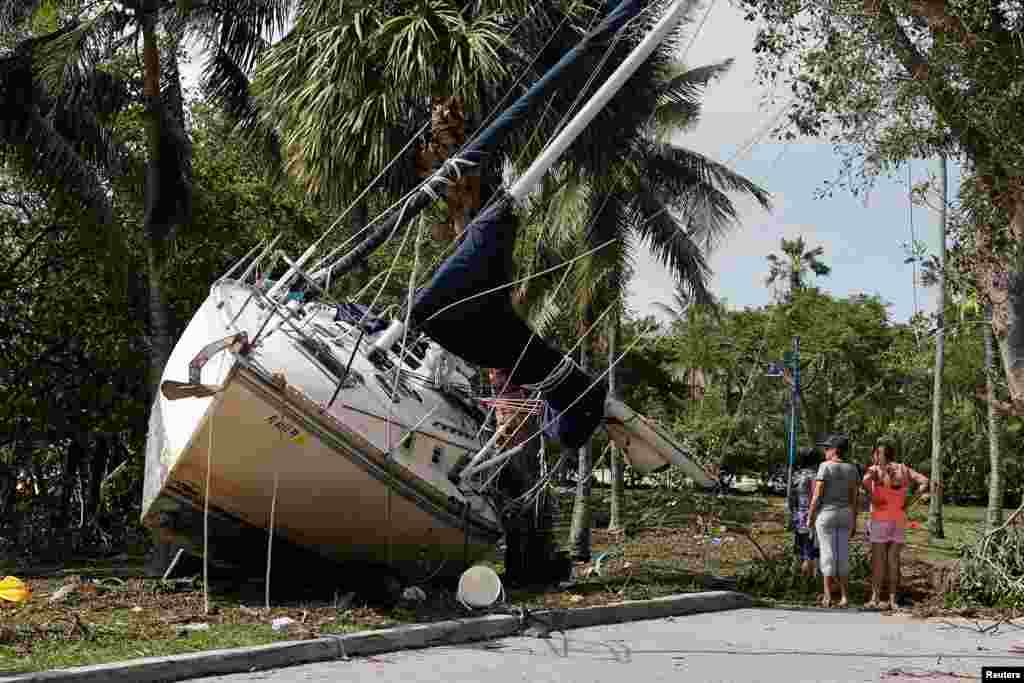 A Wrecked boat comed ashore in Coconut Grove following Hurricane Irma in Miami, Florida.