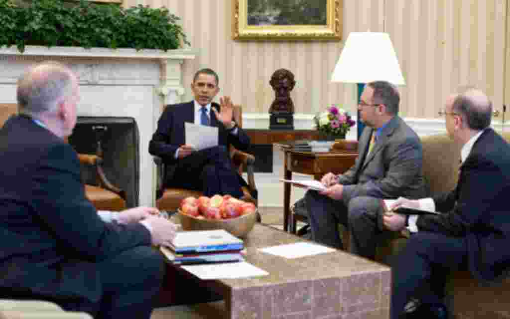President Barack Obama receives a briefing on the earthquake in Japan and the tsunami warnings across the Pacific in the Oval Office, March 11, 2011. Briefing the President, from left, are: Assistant to the President for Homeland Security John Brennan; Na