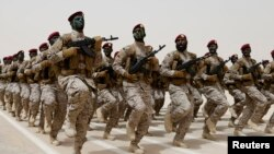 FILE - Saudi soldiers march during a military drill in Hafar Al-Batin, Saudi Arabia.