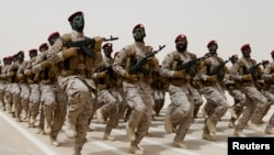 FILE - Saudi soldiers march during a military drill in Hafar Al-Batin, Saudi Arabia.