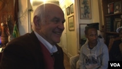 Bill Staab in his New York apartment with some Ethiopian visitors.