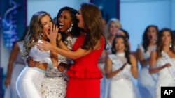 Miss Georgia Betty Cantrell, left, reacts with Miss South Carolina Daja Dial, center, and Miss Oklahoma Georgia Frazier after being named Miss America 2016, Sunday, Sept. 13, 2015.