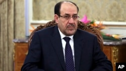 FILE - Iraqi Prime Minister Nouri al-Maliki pictured during a meeting in Tehran, Iran on Dec. 5, 2013.