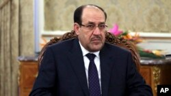 FILE - Iraqi Prime Minister Nouri al-Maliki, shown here, has met with Iranian Gen. Ghasem Soleimani.
