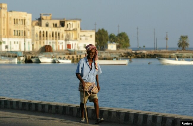 FILE - An Eritrean man walks alongside the Red Sea port of Massawa, 150 kilometers from the capital, Asmara.